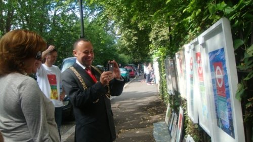 Mayor of Lambeth taking picture of art work on display in Josephine Avenue